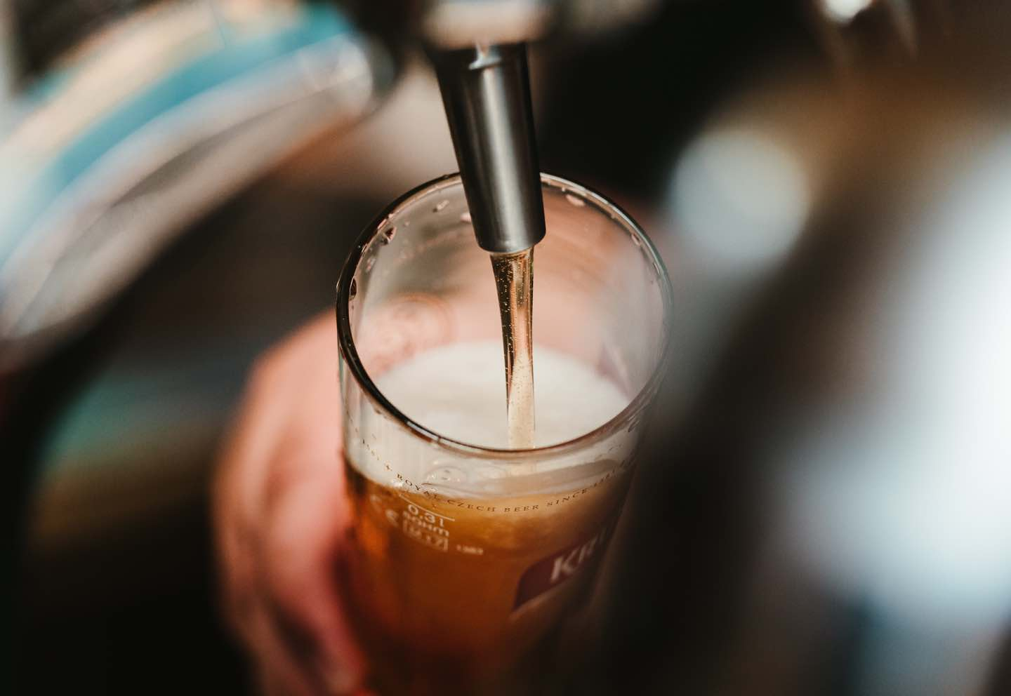 Pouring beer on tap